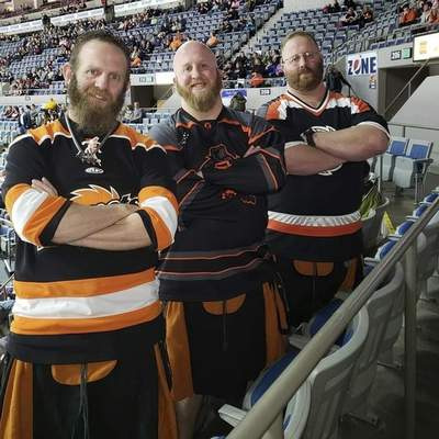 Courtesy Caleb Moore, middle, and his brothers, Rob, left, and Ryan pose with their distinctive kilts during a Komets game at the Coliseum. Caleb overcame COVID-19 recently and is looking forward to returning to games with his three kids.