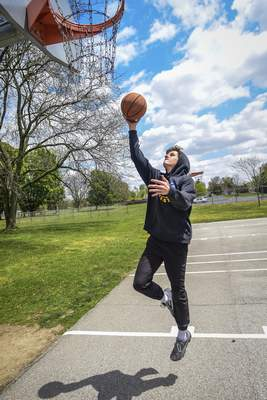 Mike Moore | The Journal Gazette  Blackhawk Christian freshman Brenna Miller, 17 shoots hoops Tuesday afternoon at Northside Park on Parnell Ave.
