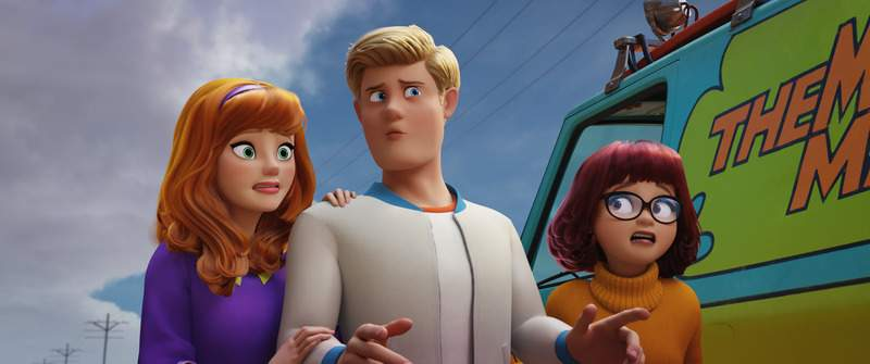 This image released by Warner Bros. Pictures shows animated characters, from left, Daphne Blake, voiced by Amanda Seyfried, Fred Jones, voiced by Zac Efron and Velma Dinkley, voiced by Gina Rodriguez, in a scene from