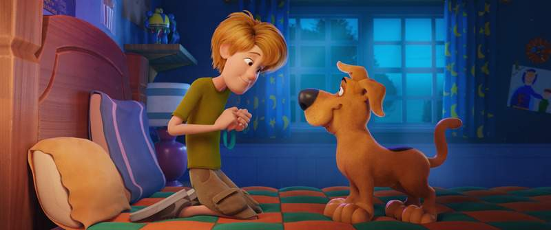 This image released by Warner Bros. Pictures shows animated characters, Scooby-Doo, right, and a young Shaggy Rogers, voiced by Iain Armitage, in a scene from
