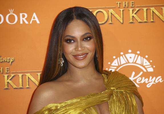 FILE - This July 14, 2019 file photo shows Beyonce at the Lion King premiere in London. (Photo by Joel C Ryan/Invision/AP, File)
