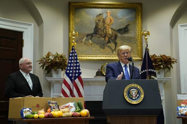 Associated Press President Donald Trump speaks on the effect of the coronavirus pandemic on the food supply chain Tuesday at the White House. Agriculture Secretary Sonny Perdue looks on at left.