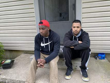 Jamie Duffy | The Journal Gazette Daimond Veazey, left, and Max Curry were Jaden Nelson's friends. They went to his home  to mourn with the family after Nelson was killed Tuesday.