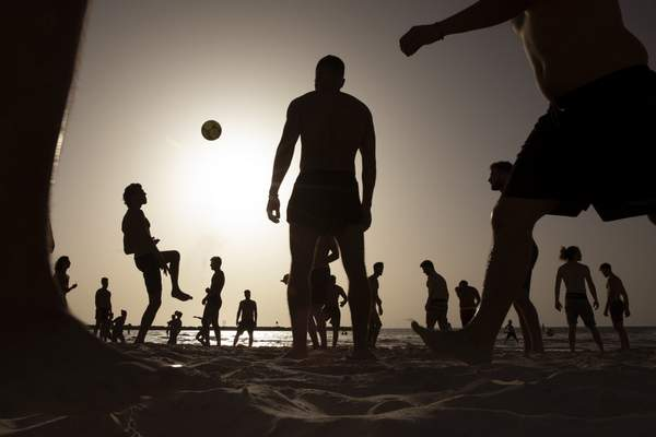 Associated Press photos People enjoy the seashorein Tel Aviv, Israel, on Wednesday, the first day the Mediterranean city's iconic beaches reopened as part of the lifting of coronavirus restrictions.