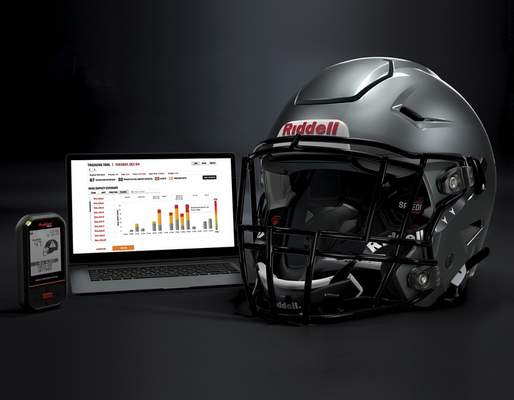 Associated Press A Riddell SpeedFlex helmet sits next to a computer screen. The NFL is examining ways to fit a face guard on helmets that could stop the spread of the coronavirus.