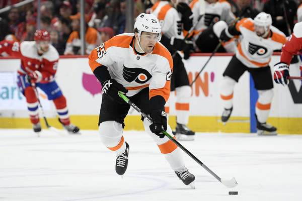 FI:LE - In this March 4, 2020, file photo, Philadelphia Flyers left wing James van Riemsdyk (25) skates with the puck during the first period of an NHL hockey game against the Washington Capitals in Washington. Van Riemsdyk can't keep track of the secondary assists while his family is quarantined with his in-laws: it's all hands on deck while the Flyers star and his wife celebrated the birth of their daughter. (AP Photo/Nick Wass)