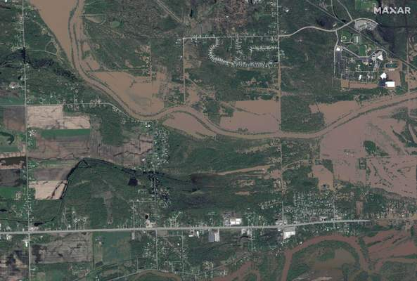This photo provided by Maxar Technologies shows the flooded Tittabawassee River around the areas in Midland, Mich., Wednesday, May 20, 2020. (Maxar Technologies via AP)