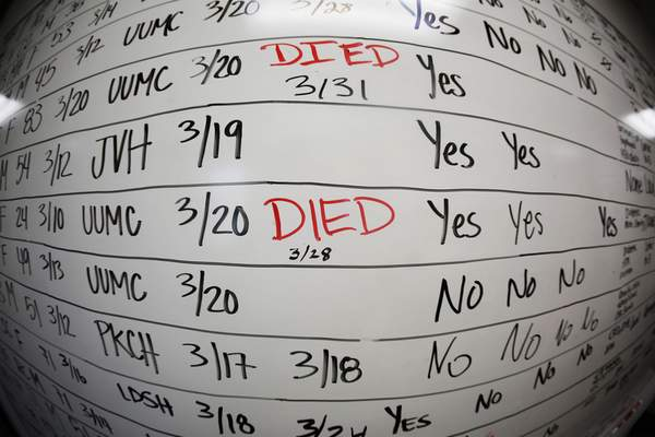 This May 13, 2020, photo taken with a fisheye lens shows a list of the confirmed COVID-19 cases in Salt Lake County early in the coronavirus pandemic at the Salt Lake County Health Department, in Salt Lake City. (AP Photo/Rick Bowmer)