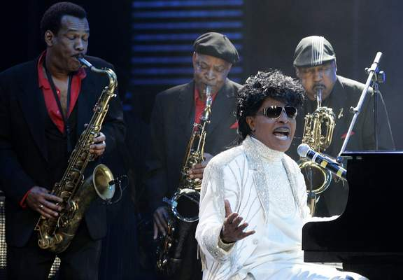 FILE - In this May 30, 2009 file photo, Little Richard performs at The Domino Effect, a tribute concert to New Orleans rock and roll musician Fats Domino, at the New Orleans Arena in New Orleans. (AP Photo/Patrick Semansky, File)