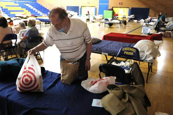 Associated Press Dan Roberts packs his belongings Thursday as he prepares to move out of a high school in Midland, Mich., that has housed flood evacuees.