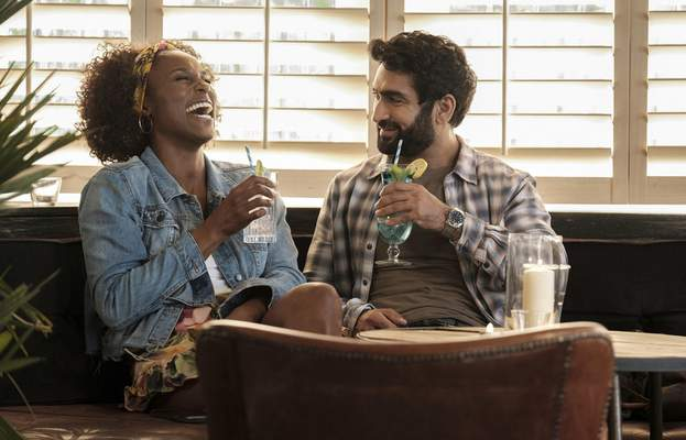 This image released by Netflix shows Issa Rae as Leilani, left, and Kumail Nanjiana as Jibran in a scene from The Lovebirds. (Skip Bolen/Netflix via AP)