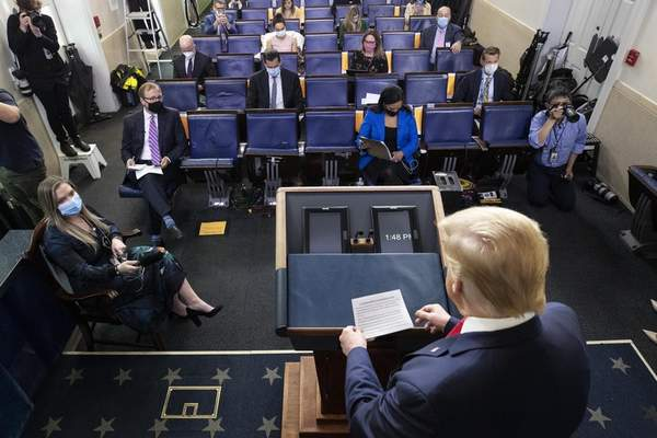 Associated Press President Donald Trump prepares to speak with reporters about the coronavirus outbreak Friday at the White House.