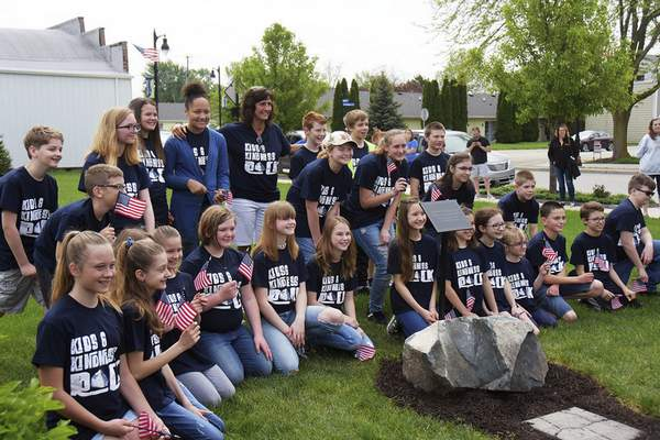 Katie Fyfe   The Journal Gazette  Joni Price and her fifth graders take a photo in front of the Woodburn Wishing Stone during itsdedication on Saturday.