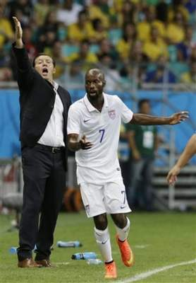 Belgium's head coach Marc Wilmots gestures during the World Cup round of 16 soccer match between Belgium and the USA at the Arena Fonte Nova in Salvador, Brazil, Tuesday, July 1, 2014. At right isUnited States' DaMarcus Beasley. (AP Photo/Matt Dunham)
