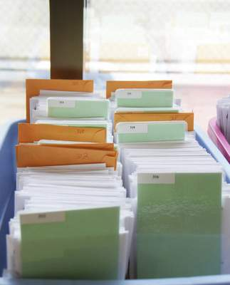 Katie Fyfe | The Journal Gazette About 20,000 ballots are collected in the Election Board office at the Rousseau Centre on Thursday, May 21st, 2020.