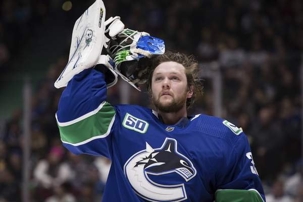 """Associated Press Canucks goalie Thatcher Demko, 24, says he would not oppose players being isolated from family. """"I don't have many roots,"""" he says. Other players say they'd object."""