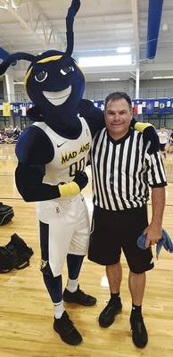 Courtesy Local referee Shane Salisbury hangs out with the Mad Ants' mascot during a clinic this past season.