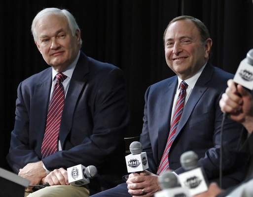 FILE - In this Jan. 24, 2015, file photo, NHL Player's Association executive director Donald Fehr, left, and NHL Commissioner Gary Bettman are shown during a news conference at Nationwide Arena in Columbus, Ohio. The NHL is one step closer to returning. Commissioner Gary Bettman unveiled a 24-team straight to playoffs format the league will use if it can clear the other hurdles to resume its season. The announcement comes on the heels of the league and NHLPA issuing an extensive series of protocols once players are allowed to return to their facilities. (AP Photo/Gene J. Puskar, File)
