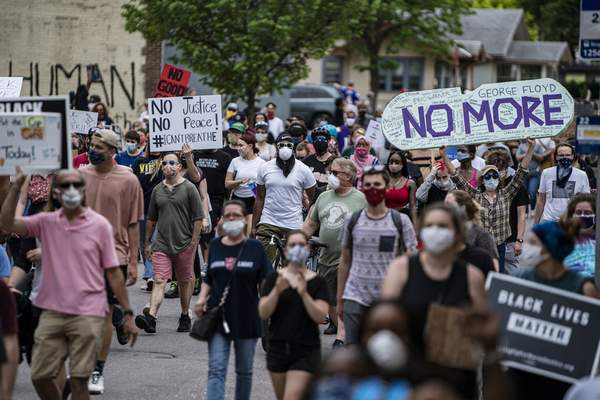 Associated Press Protesters started marching toward the Minneapolis Police 3rd Precinct after gathering Tuesday. Four Minneapolis officers involved in the arrest of George Floyd, a black man who died in police custody, were fired Tuesday, hours after a video showed an officer kneeling on the handcuffed man's neck.