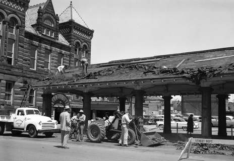 File April 29, 1957:Workers begin razing the 47-year-old north pavilion of the Barr Street Market behind what at the time was City Hall, seen at left. The pavilion had been deemed structurally unsafe.