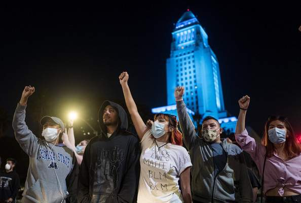 Demonstrators gather during a protest Wednesday, May 27, 2020, in Los Angeles over the death of George Floyd in Minneapolis police custody earlier in the week. (AP Photo/Ringo H.W. Chiu)
