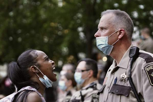 A woman yells at a sheriff's deputy during a protest following the death of George Floyd at the hand of Minneapolis police officers, Thursday, May 28, 2020, in Minneapolis. (Mark Vancleave/Star Tribune via AP)