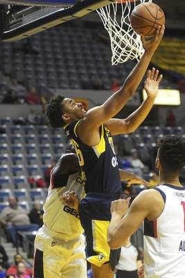 Katie Fyfe | The Journal Gazette  Ben Moore goes for a reverse layup at Memorial Coliseum this season for the Mad Ants.