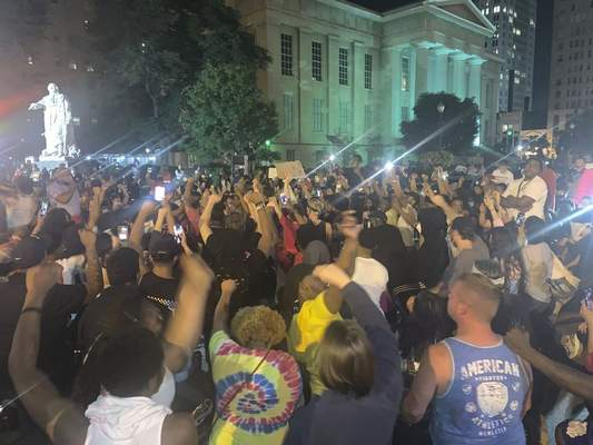 In a photo provided by Jada W., protesters gather Thursday, May 28, 2020, in downtown Louisville, Ky., against the police shooting of Breonna Taylor, a black woman fatally shot by police in her home in March. At least seven people were shot during the protest. (Jada W. via AP)
