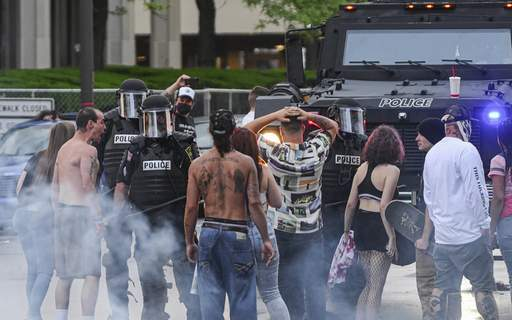 Photos byMike Moore | The Journal Gazette Protesters walk up to Fort Wayne police during a confrontation downtown Friday evening. (The_Journal_Gazette)