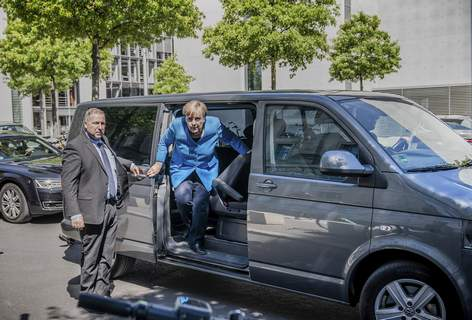 Virus Outbreak Germany Merkel Chancellor Angela Merkel steps out of a minibus as she arrives for a parliament session at the Reichstag building in Berlin, Germany, Friday, May 29, 2020. Because of the coronavirus crisis the Merkel is chauffeured in a minibus in order to keep the distance rules. (Michael Kappeler/dpa via AP) (Michael Kappeler