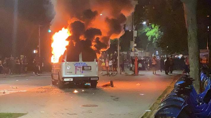 In this photo provided by Khadijah, flames erupt from a New York City Police Department van set ablaze, Friday, May 29, 2020, in the Brooklyn borough of New York, during a protest of the death of George Floyd in police custody on Memorial Day in Minneapolis. (Khadijah via AP)