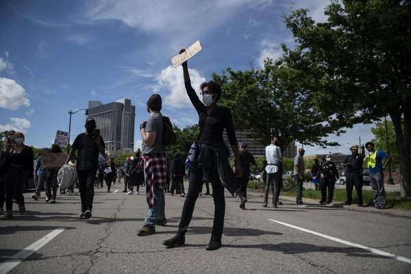 People march in Detroit during a rally calling for an end to police violence after the death of George Floyd, a handcuffed black man who died Memorial Day in the custody of the Minneapolis police, Friday May 29, 2020. (Nicole Hester/Ann Arbor News via AP)