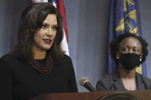 Virus Outbreak Michigan In this photo provided by the Michigan Executive Office of the Governor, Gov. Gretchen Whitmer speaks during a news conference Friday, May 29, 2020, in Lansing, Mich. Whitmer hinted that she will soon reopen more regions of Michigan, expressing optimism as long as the rate of new coronavirus cases continues downward and testing increases. (Michigan Executive Office of the Governor via AP) (HOGP)