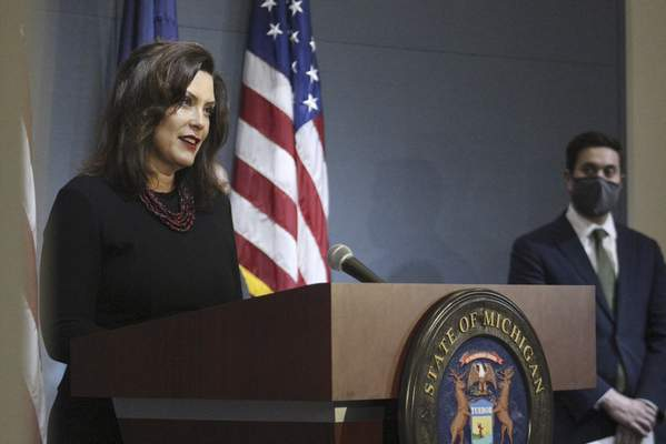 In this photo provided by the Michigan Executive Office of the Governor, Gov. Gretchen Whitmer speaks during a news conference Friday, May 29, 2020, in Lansing, Mich. Whitmer hinted that she will soon reopen more regions of Michigan, expressing optimism as long as the rate of new coronavirus cases continues downward and testing increases. (Michigan Executive Office of the Governor via AP)