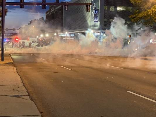 Journal Gazette Jamie Duffy  Police tear gas deployed shortly after 9:30 p.m. dispersed the crowd from the Allen County Courthouse to other downtown locations.