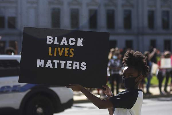Katie Fyfe | The Journal Gazette  A protester holds a sign reading Black Lives Matters during the protest of thedeath of George Floyd on Sunday.