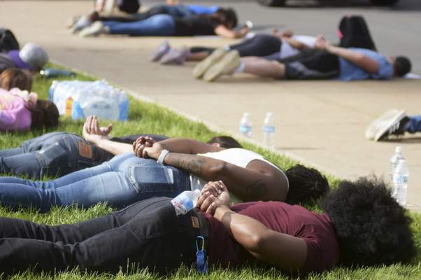 Katie Fyfe | The Journal Gazette  Protesters lay on their stomachs with their hands behind their backs and shout I Can't Breathe to protest the death of George Floyd on Sunday.