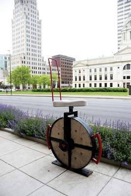 Katie Fyfe | The Journal Gazette A newly carved unicycle is installed on Clinton Street on Saturday, May 23rd, 2020.