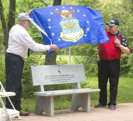 Michelle Davies | The Journal Gazette Spec 4 Phil Hall, left, a member of Company C, 2nd Battalion, 1th Infantry Division, and Pat Fraizer, right, 1st Vice Commander of the National Veterans Memorial Shrine and Museum, unveil a bench dedicated to the memory of A1C William H. Pitsenbarger. Pitsenbarger' received the Medal of Honor for bravery and compassion while assisting Company C, 2nd Battalion, 16th Infantry of the 1st Infantry Division, who were under attack on April 11, 1966 during the Vietnam War.