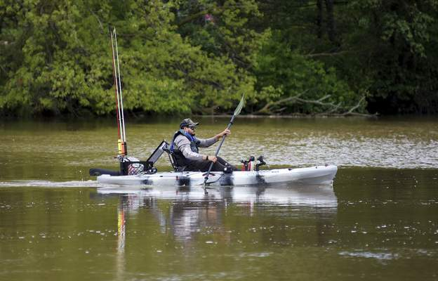 Katie Fyfe | The Journal Gazette Larry Reyes goes for a kayak ride along the Cedarville Reservoir in Leo on Saturday, May 23rd, 2020.
