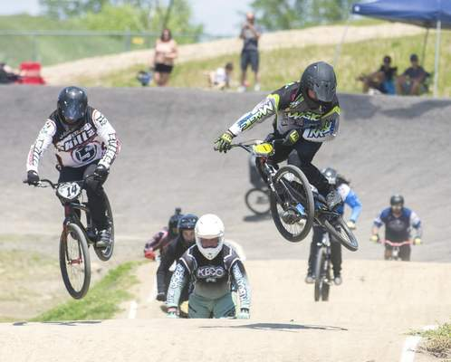 Michelle Davies | The Journal Gazette Austin Kelly, right, of Lapeer, Michigan, comes in ahead of Jason Wagner, of Mishawaka, Indiana, left, during the 36-40 Cruiser heat at Sunday's season opener at the Fort Wayne BMX Park.