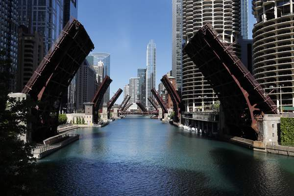 Several street bridges over the Chicago River remain closed early Sunday morning, May 31, 2020 in Chicago, after a night of unrest and protests over the death of George Floyd, a black man who was in police custody in Minneapolis. (AP Photo/Charles Rex Arbogast)