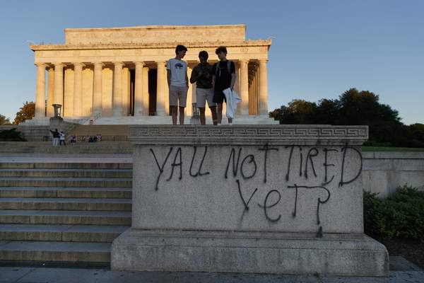 Spray paint that reads Yall Not Tired Yet? is seen on the base fo the Lincoln Memorial on the National Mall in Washington, early Sunday, May 31, 2020, the morning after protests over the death of George Floyd. Floyd died after being restrained by Minneapolis police officers on Memorial Day. (AP Photo/Carolyn Kaster)