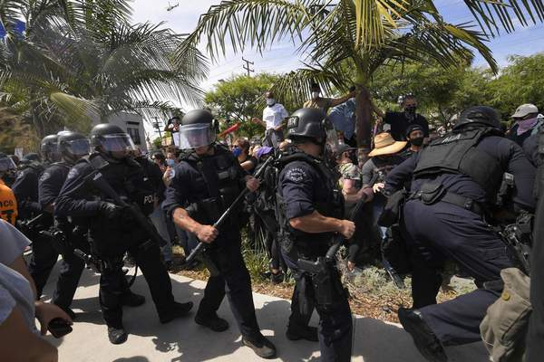 Los Angeles police officers move demonstrators back during a protest over the death of George Floyd, Saturday, May 30, 2020, in Los Angeles. (AP Photo/Mark J. Terrill)