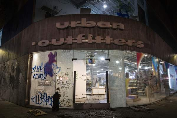 An urban outfitters is left vandalized and emptied on Melrose Avenue in Los Angeles, Saturday, May 30, 2020, following a protest over the death of George Floyd, a black man who was killed in police custody in Minneapolis on May 25. (AP Photo/Christian Monterrosa)