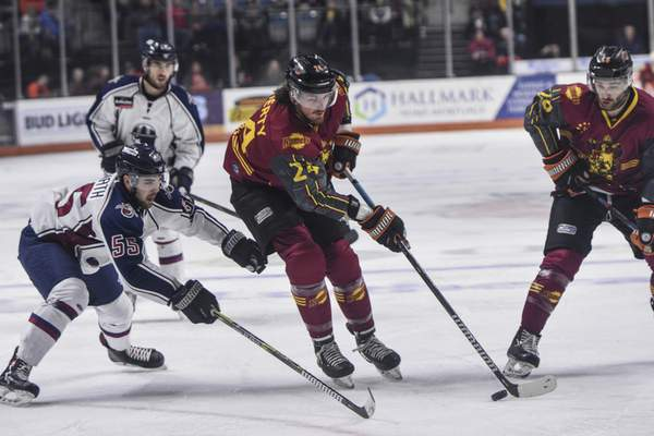 Mike Moore | The Journal Gazette  Taylor Doherty, middle, was the only eligible player not protected by the Komets on Monday.