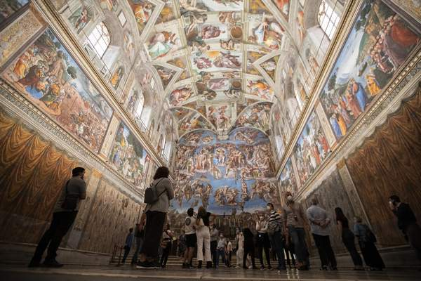 Visitors admire the Sistine Chapel as the Vatican Museum reopened, in Rome, Monday, June 1, 2020. The Vatican Museums reopened Monday to visitors after three months of shutdown following COVID-19 containment measures. (AP Photo/Alessandra Tarantino)