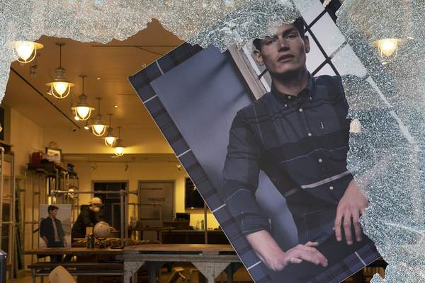 A store window is smashed, Monday, June 1, 2020, in the SoHo neighbourhood of New York. Protesters broke into the store Sunday night in reaction to George Floyd's death while in police custody on May 25 in Minneapolis. (AP Photo/Mark Lennihan)
