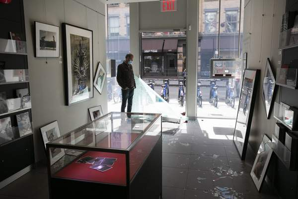 Elliot Kurland, owner of the Leica Gallery New York, stands in the front of his store, Monday, June 1, 2020, in the SoHo neighbourhood of New York. Protesters broke into the camera store Sunday night, stealing expensive camera equipment, in reaction to George Floyd's death while in police custody on May 25 in Minneapolis. (AP Photo/Mark Lennihan)