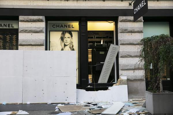 The windows of a Chanel store are broken Monday, June 1, 2020, following protests in the SoHo neighborhood of New York. (AP Photo/Mark Lennihan)